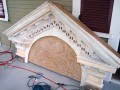 The pediment after sanding, filling, and one round of primer.