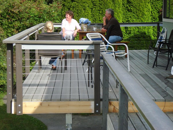 The culmination of Phase 1: John and Betty enjoy lemonades with Jackson on their newly expanded deck.