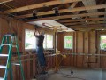 After passing rough inspections, Jeff begins hanging drywall in the new kitchen.